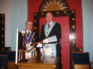 W.Bro Dr P.A.Mundell presenting W.Bro Andrew Gailes Conside Lodge with the Vulcan Travelling Gavel 1th November 2012